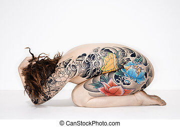 Nude tattooed woman - Nude caucasian woman with tattoos...