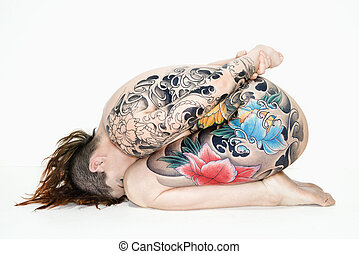 Nude tattooed woman on side - Nude caucasian woman with...