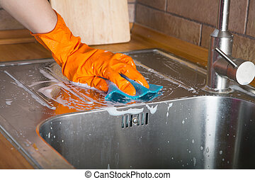 Cleaning sink - Rubber gloved hand cleaning sink with duster