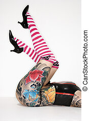 Tattooed womans legs - Legs of adult caucasian woman with...