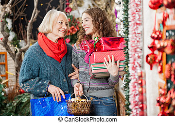 Happy Mother And Daughter With Christmas Presents - Happy...