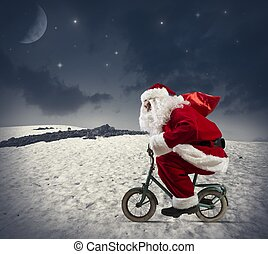 Santa claus on the bike in the mountains