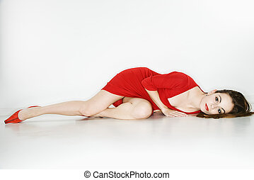 Pretty woman lying down. - Attractive Caucasian woman...