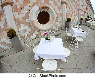 bar tables above the basilica palladiana in vicenza -...