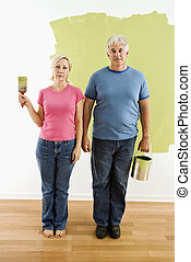 Couple with painting utensils - Portrait of unhappy adult...