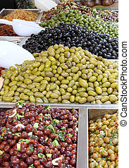 tasty seasoned olives for sale at vegetable market directly...