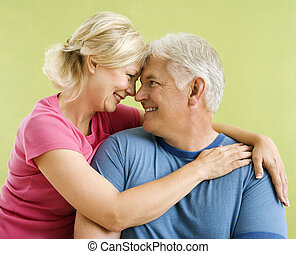 Happy smiling couple. - Portrait of smiling middle-aged...