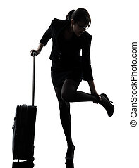 business woman traveling massaging feet silhouette - one...
