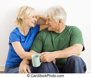 Man and woman relaxing together. - Middle-aged couple...