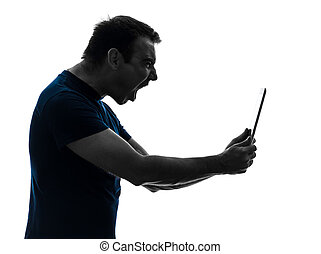 man holding digital tablet screaming angry furious - one...