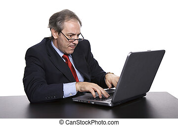 worried - mature business man working with his laptop