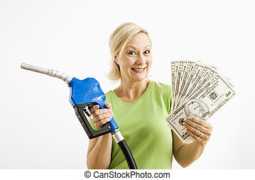 Happy woman with gas pump and money - Portrait of smiling...