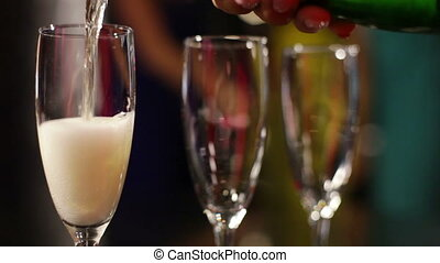 Sparkling wine - Close-up of three flutes being filled with...