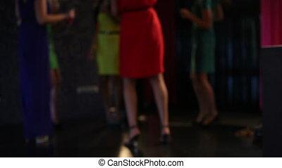 Karaoke girls - Confident ladies singing karaoke in the club