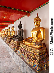 buddha statues made of gold and black brass