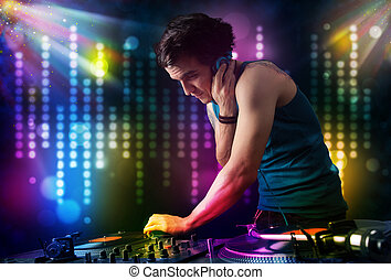 Dj playing songs in a disco with light show - Young Dj...
