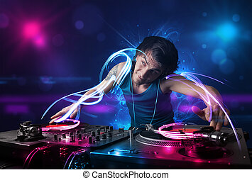 Disc jockey playing music with electro light effects and...