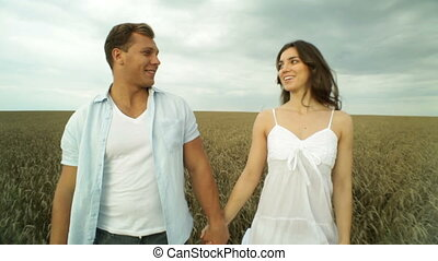 Sweet date - Young couple dating in the fields enjoying the...