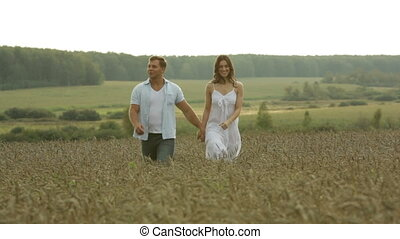 Carefree lovers - Carefree sweethearts walking in the fields...