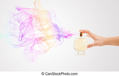 woman hands spraying perfume - close up of woman hands...