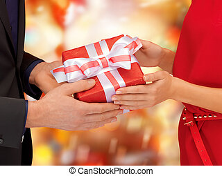 man and woman hands with gift box - christmas, x-mas,...