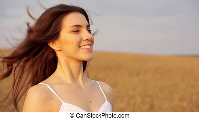 Breath of nature - Beautiful young woman standing in the...