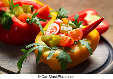 Closeup of fresh vegetables served in bell pepper
