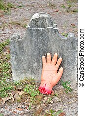 Haunted Halloween Hand - A Halloween gag hand is placed by a...