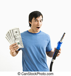 Man with money and gas nozzle - Asian young man with happy...