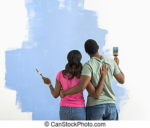 Man and woman looking at paint job. - African American...