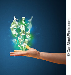Glowing money in the hand of a woman