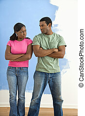 Angry man and woman - African American couple glaring at...