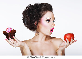 Surprised Funny Woman Decides between Apple and Cake