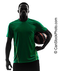 african man soccer player  holding football silhouette