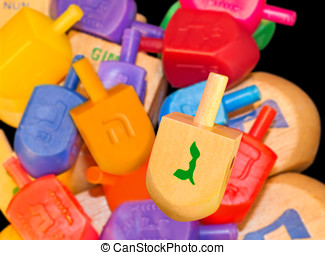Colorful Chanukah dreidels - Group of wood and plastic...