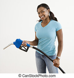 Woman with gas nozzle - African American young adult female...