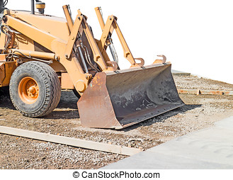 Close up of heavy construction equipment tire and front...