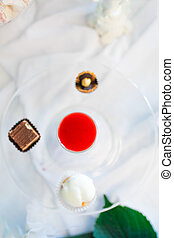 Liquor and candies on a plate - Serving holiday table Liquor...