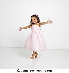Little girl twirling - Cute little hispanic girl wearing...