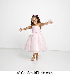 Little girl twirling - Cute little hispanic girl wearing...