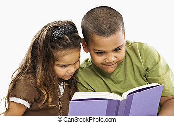 Brother and sister reading book.