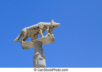 Romulus and Remus with wolf mother - A sculpture of Romulus...