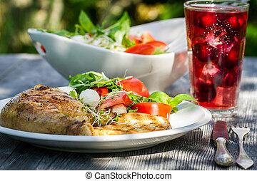 Freshly served dinner in the summer garden