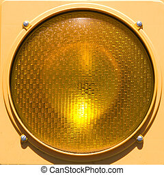 Closeup of stoplight. - Closeup of yellow traffic stoplight.