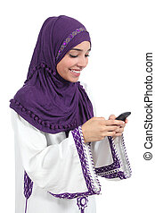 Beautiful arab woman browsing her smart phone isolated on a...