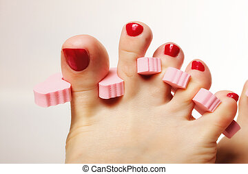 foot pedicure applying red toenails - foot pedicure applying...