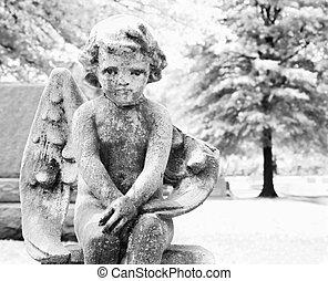 Cherub statue in graveyard - Statue in graveyard of cherub.