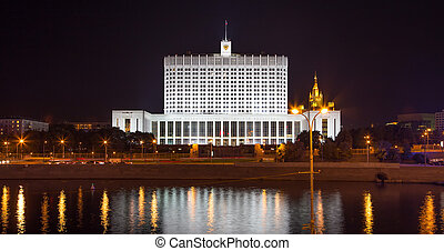 House of Government in Moscow, Russia, at night. Inscription...