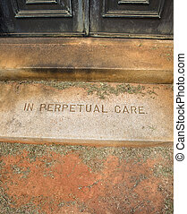 Mausoleum entrance in graveyard with words, \'In Perpetual...