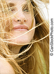 Woman\'s face in wind. - Close up portrait of attractive...